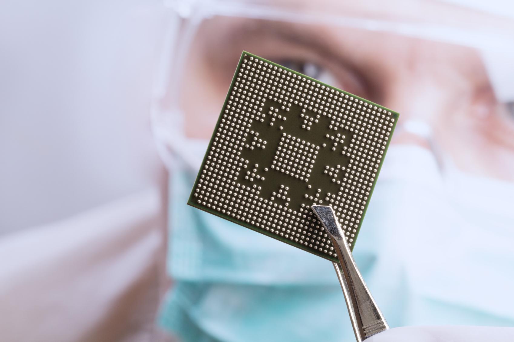 Stock Semiconductor Testing : Brisbane digital director gets microchip implant ahead of
