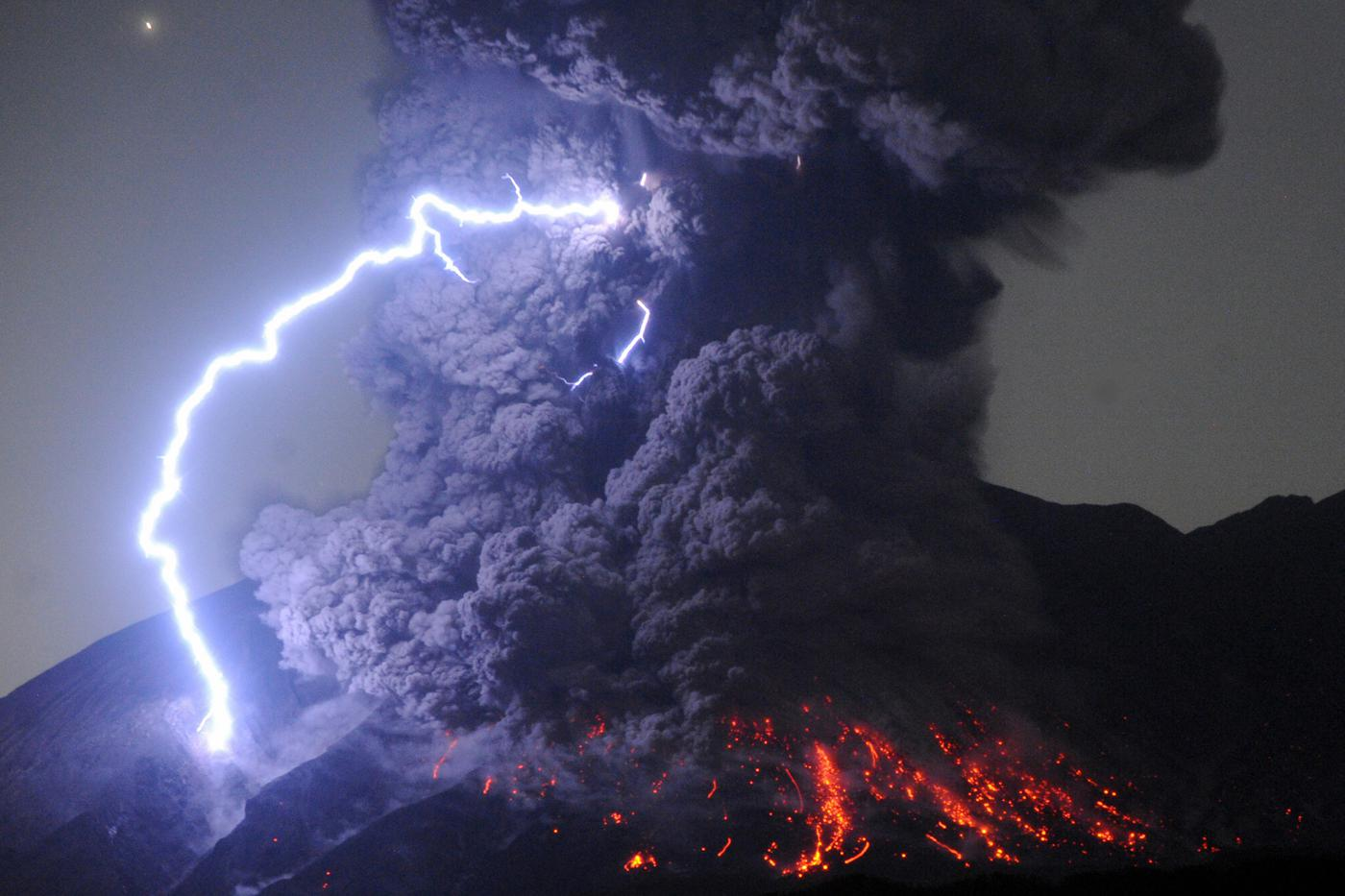 TARUMIZU, JAPAN - JULY 26: (CHINA OUT, SOUTH KOREA OUT) A dirty thunderstorm occurs over Mount Sakurajima as the volcano erupts violently at 12:03 am on July 26, 2016 in Tarumizu, Kagoshima, Japan. The eruption occurred at the mountain's Showa crater. This is the first time that the active volcano in southern Kyushu has spewed out a smokestack that high since an eruption on August 18, 2013, according to the Kagoshima Meteorological Office. (Photo by The Asahi Shimbun via Getty Images)