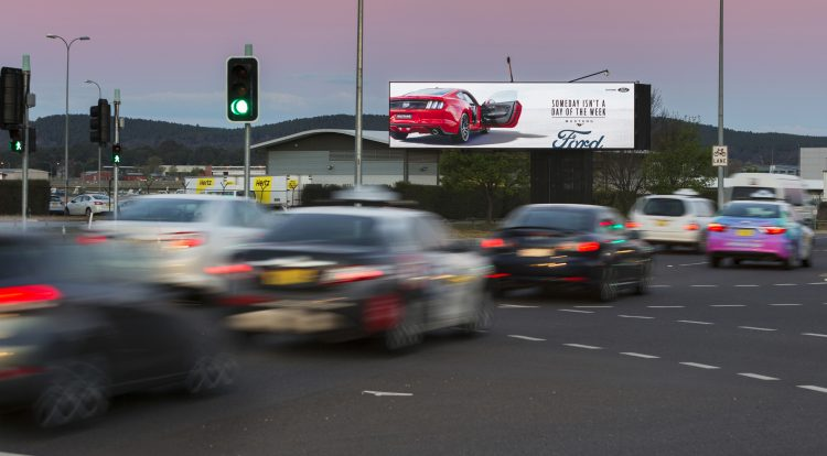 QMS Media's 'The Capitals' billboard with Ford ad