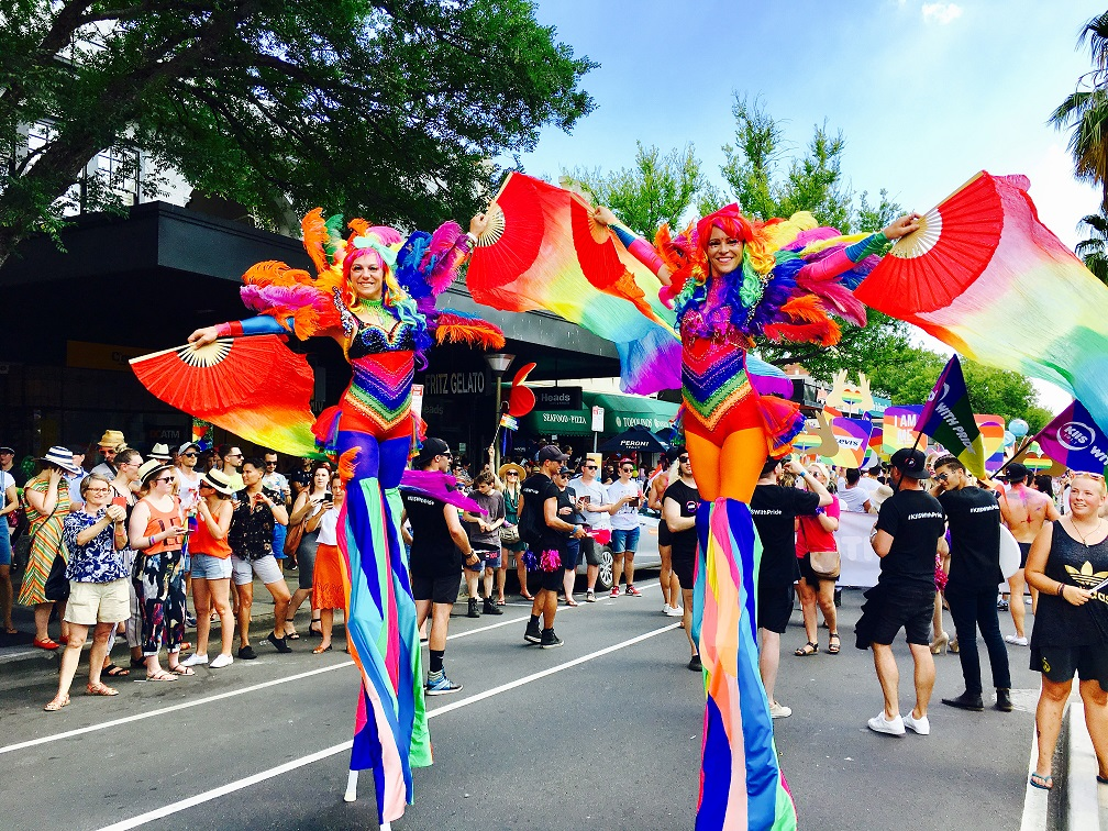 KIIS 101.1 Pride March stilt walkers