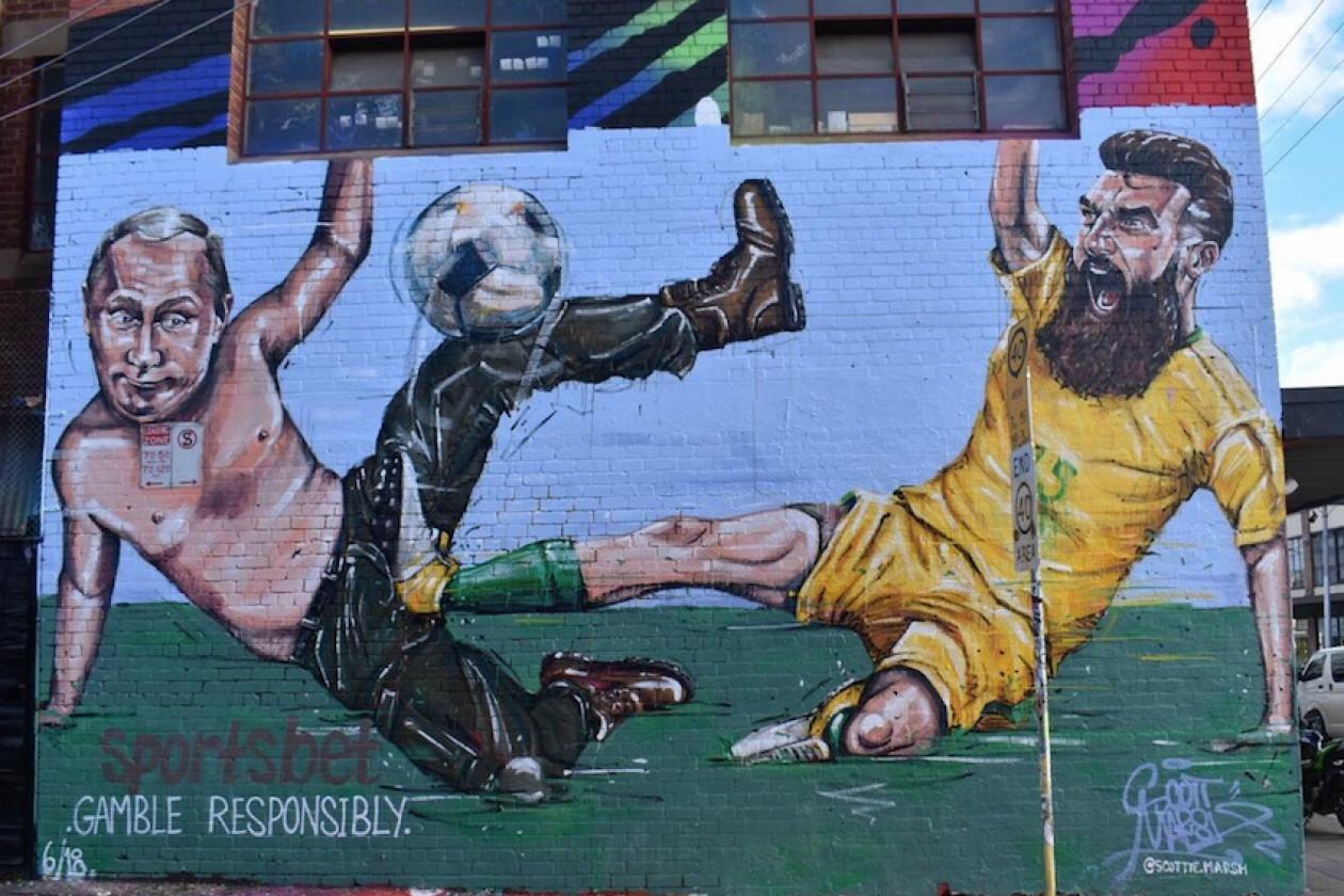 sportsbet unveils melbourne mural of socceroos captain kicking