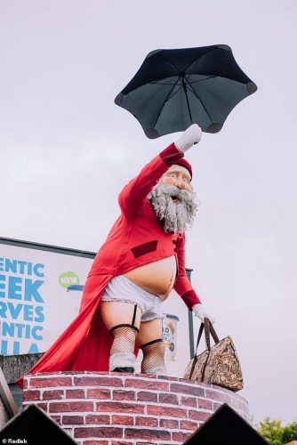 6778226-6440629-A_cross_dressing_Santa_clad_in_Mary_Poppins_style_clothing_has_b-a-7_1543464245233