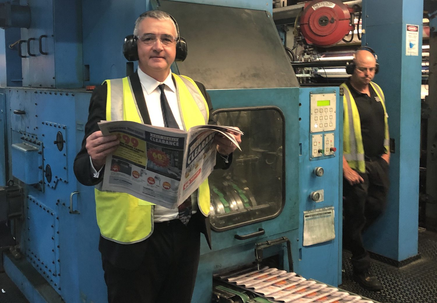 NewsLocal publisher John McGourty inspects the first edition of the new-look Macarthur Chronicle as it comes off the press