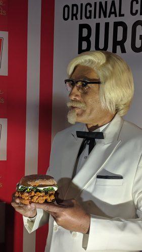 Colonel Sanders with Zinger Wax Figure at madame Tussauds Delhi