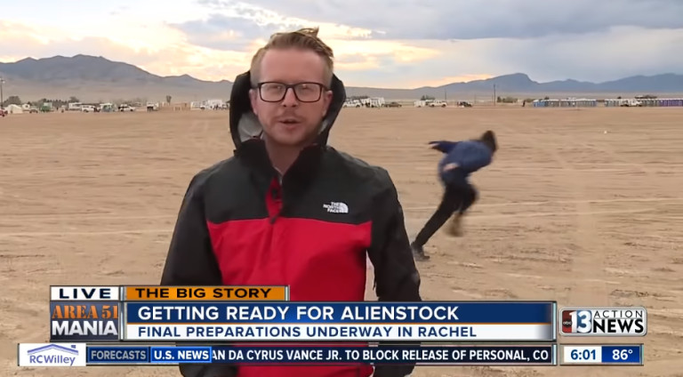 """TV Reporter Gets Gloriously Photo Bombed At """"Storm Area 51"""", As No One Bothers To Turn Up"""